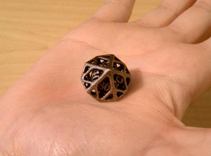 Cage Decader d10 3d printed In stainless steel and inked.