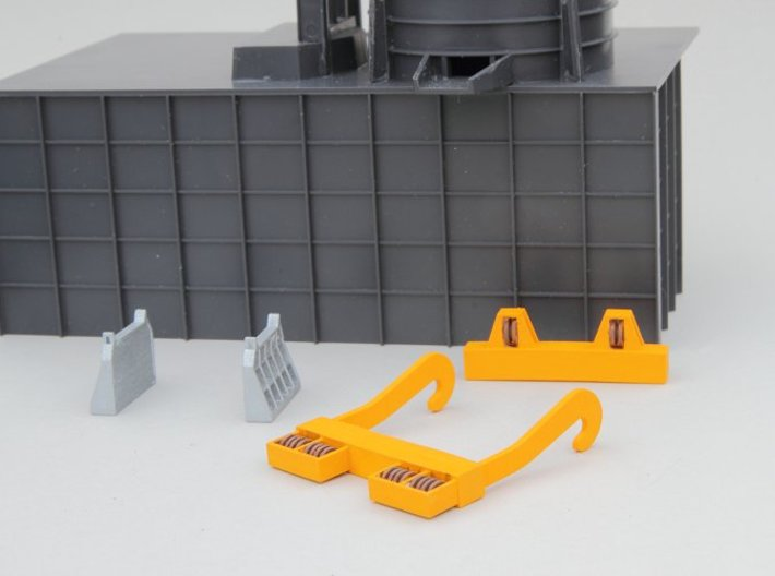 N-scale assessories for 250 ton Teeming Ladle 3d printed Crane J-hooks and yokes plus ladle stands for 250 ton teeming ladle. Walthers Cornerstone Electric Furnace shown as a background for size reference.