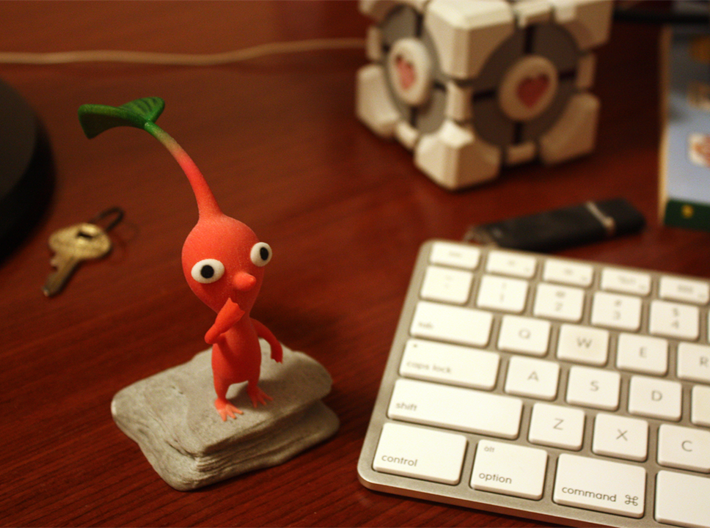 Red Pikmin Colored 3d printed Please note that the Pikmin is standing on a flat platform as opposed to a rock shaped base as this photo.