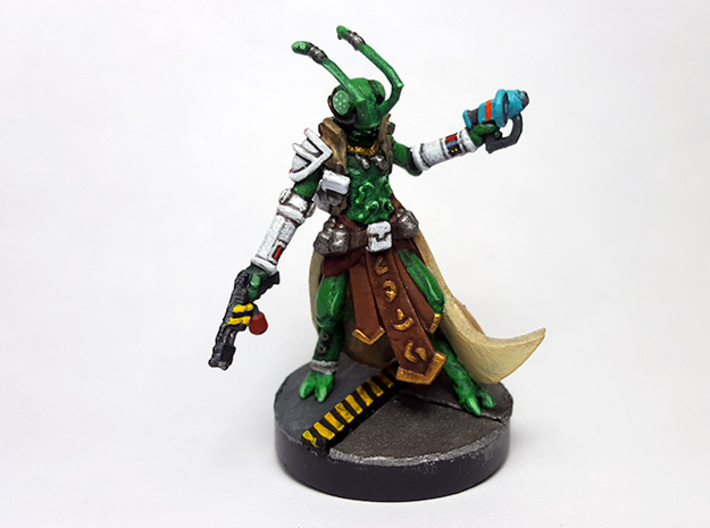 Insectoid Explorer 3d printed Painted with acrylic paints and mounted on a 1 inch base.