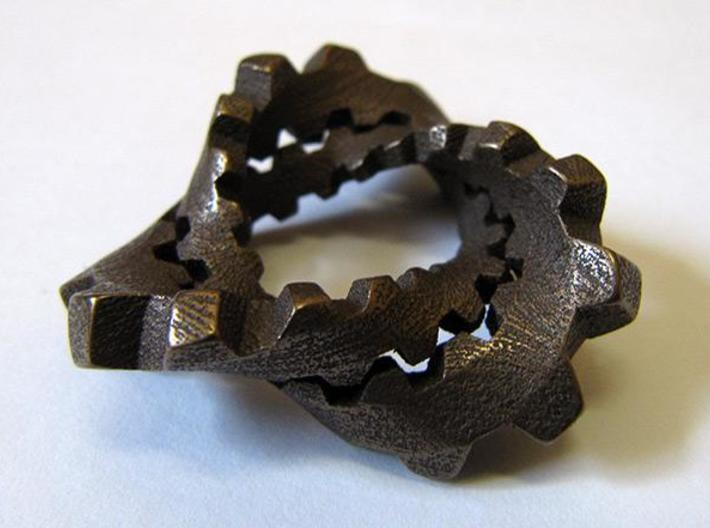 """Trefoil with Cogs 3d printed Stainless steel with """"antique bronze glossy"""" finish, from the side."""