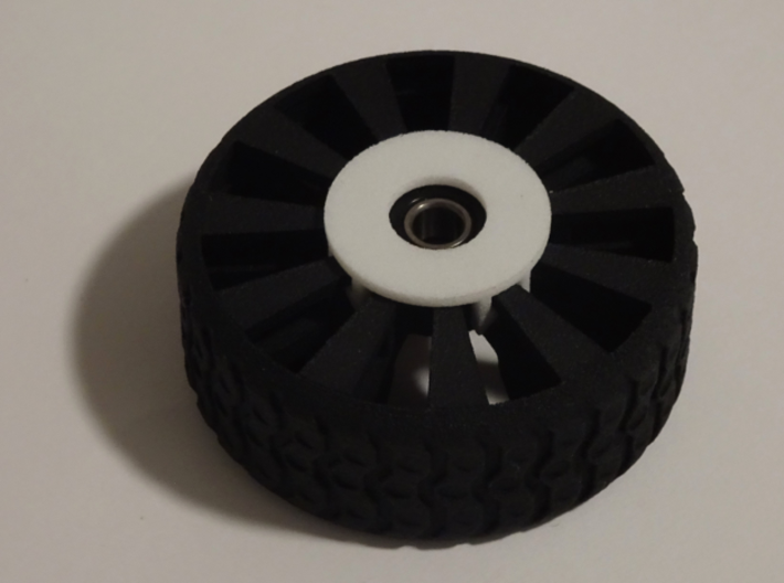 """Bearing Capture Bracket for 2 Inch Airless Tire 3d printed SHOWN WITH PRINTABLE """"2 INCH FUTURISTIC TIRE"""" AND BEARING"""
