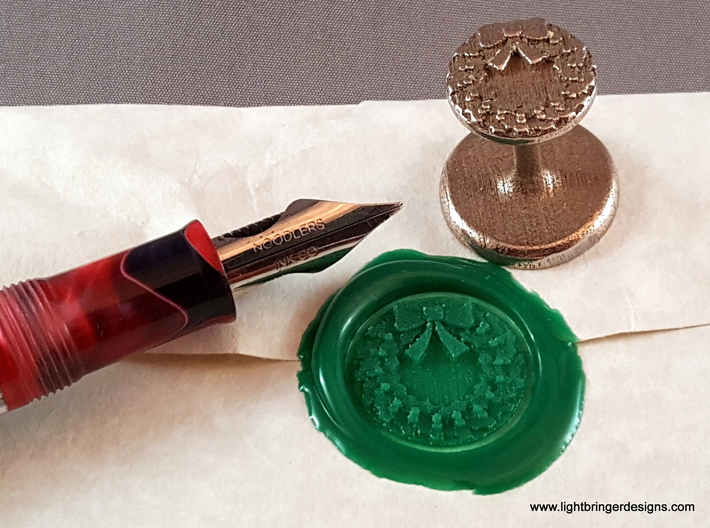Holly Wreath Wax Seal 3d printed Holly Wreath wax seal with impression and fountain pen for scale.