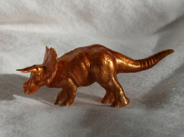 Triceratops Figurine 3d printed Hand painted with a white spray acrylic base, a few layers of gold acrylic paint, a wash of brown ink, and some protective sealer.