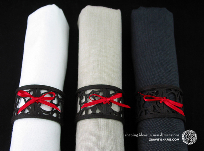 Set of 6 large napkin rings with Hearts 3d printed The photo shows an own print (FDM print) made of black wood incl. decorative lacing.