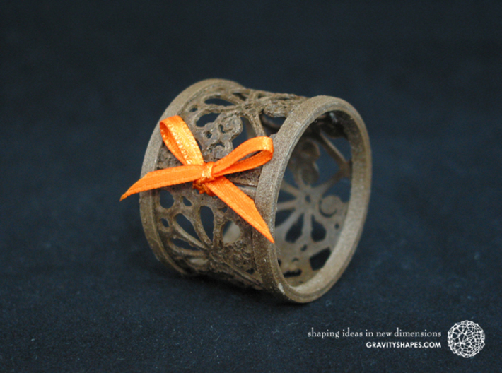 Set of 2 small napkin rings with Mosaic-3b 3d printed The photo shows an own print (FDM print) made of brown wood incl. decorative lacing.