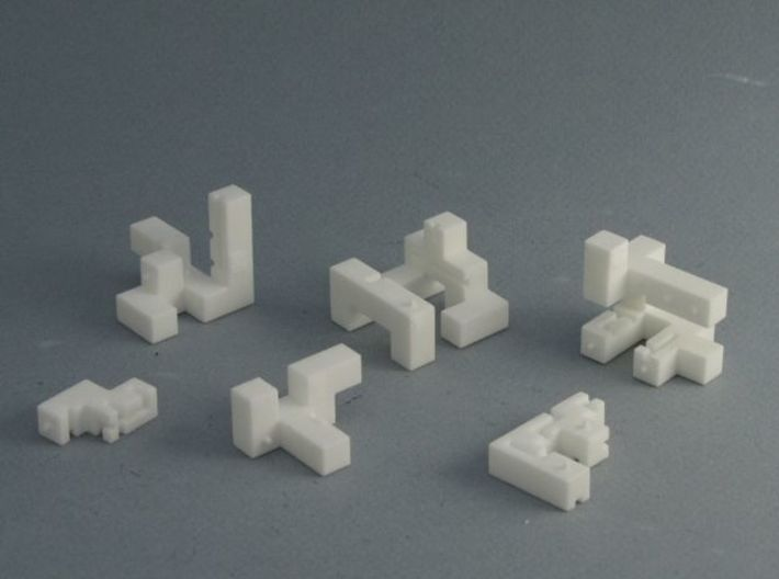 Titan – Interlocking Cube Puzzle w/ Pegs and Slots 3d printed  The Challenge is to assemble these into a cube