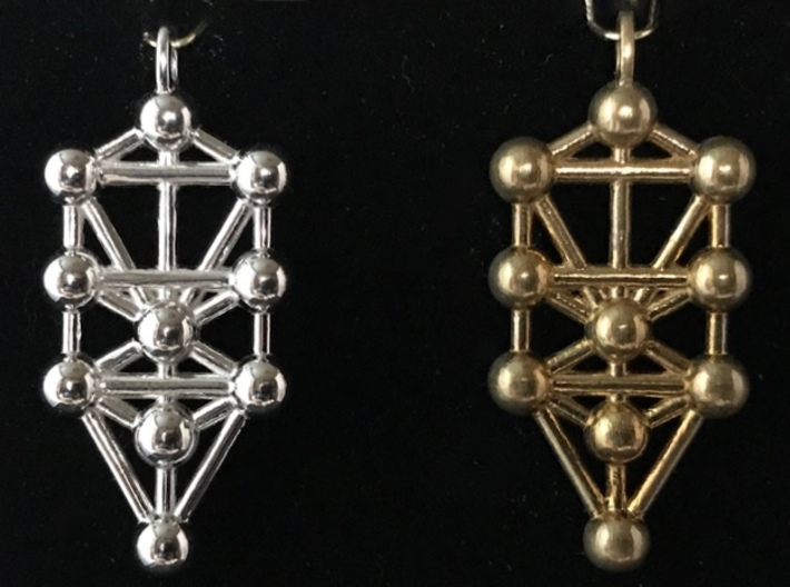 Tree Of Life Pendant 3d printed For comparison, the rhodium-plated polished pendant on the left, and the unpolished (raw) brass pendant on the right.
