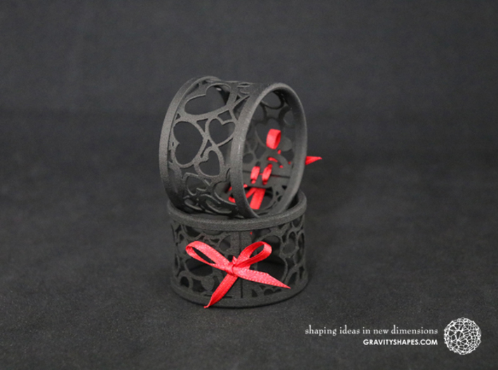 Set of 4 large napkin rings with Hearts 3d printed The photo shows prints made of black strong and flexible incl. red lacing.