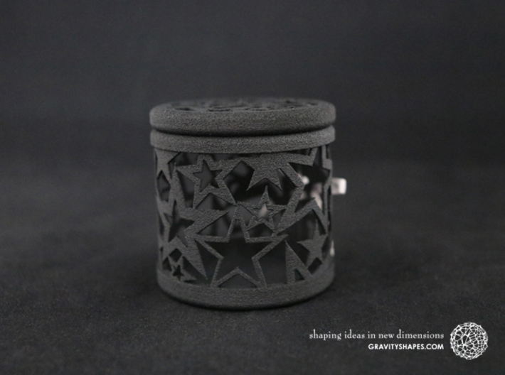Gift Box No. 1 with Stars (filigree, high) 3d printed The photo shows a print made of black strong and flexible incl. silver lacing.