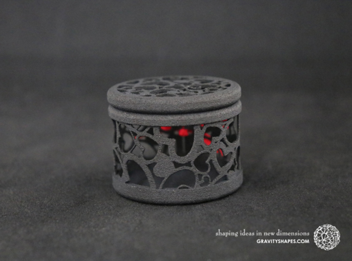 Gift Box round No. 1 with Hearts (filigree, short) 3d printed The photo shows a print made of black strong and flexible incl. red lacing.