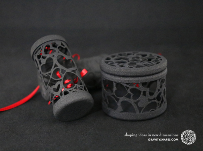 Filigree Gift roll small with Hearts (6 cm) 3d printed The photo shows prints made of black strong and flexible incl. red lacing.