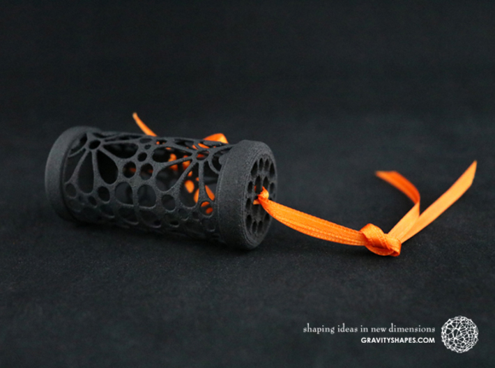 Filigree Gift roll small with Mosaic-3 (6 cm) 3d printed The photo shows a print made of black strong and flexible incl. orange lacing.