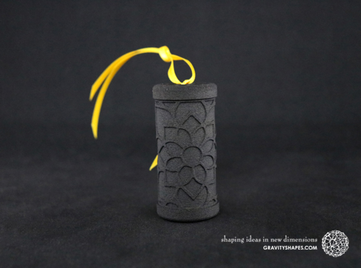 Solid Gift roll small with Mosaic-2 (6 cm) 3d printed The photo shows a print made of black strong and flexible incl. yellow lacing.
