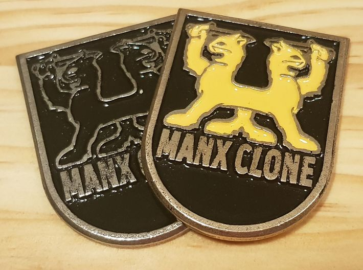 """MANX CLONE"" front badge 3d printed Printed in Polished Bronze Silver steel and painted."