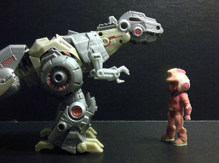Primacron homage Space Monkey 2.75inch Transformer 3d printed Size comparison 2.75 inch Primacron printed in Full Color Sandstone with Generations Voyager Class FOC Grimlock. Grimlock sold separately.