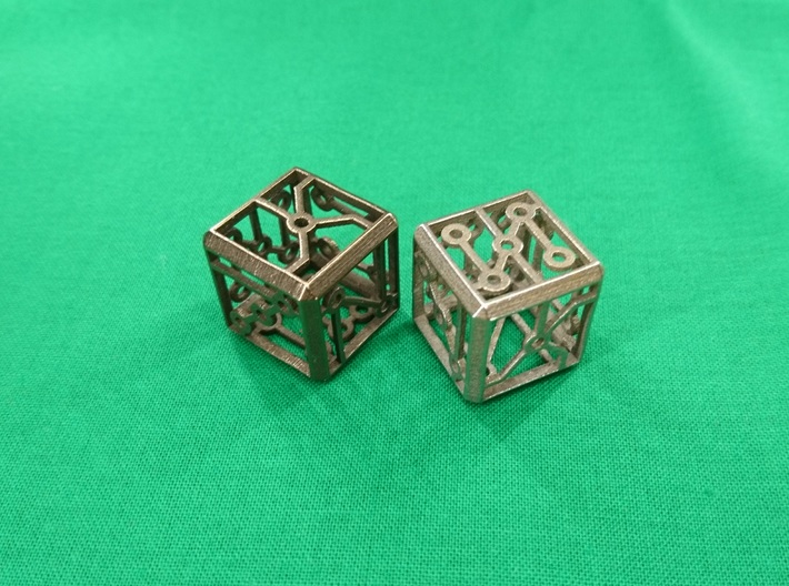 Singing Vertex Dice 3d printed Singing Vertex Dice in polished bronze steel (left) and polished bronze silver steel (right).