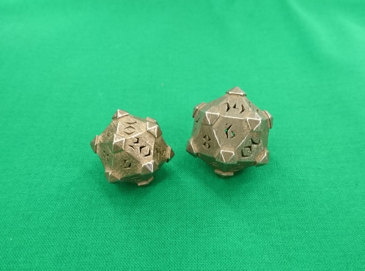 Prism D20 Closed 3d printed Prism D20 closed in polished bronze silver steel, medium left and large right.