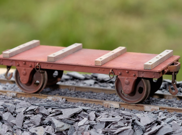 FRB04 - FR Long Slab Wagon (No Couplings) SM32 3d printed Printed in White Processed Versatile plastic.Shows fitted with AC01 axleboxes and Bearers, Slaters wheels and Couplings CPL01
