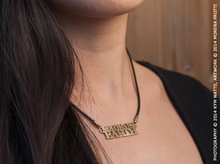 Made on EARTH Pendant 3d printed Raw Bronze. The pendant is sold alone, it comes in a velvet pouch.