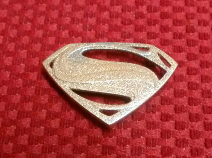 Man Of Steel Emblem - With Pegs 3d printed Front View - Stainless Steel