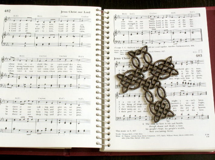 Celtic knot cross 3d printed Printed in polished bronze steel, with hymnal for scale!