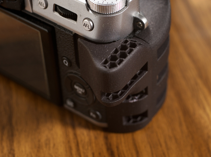 Ergonomic grip for X-T10 / X-T20 3d printed The grip als provides a comfortable thumb rest