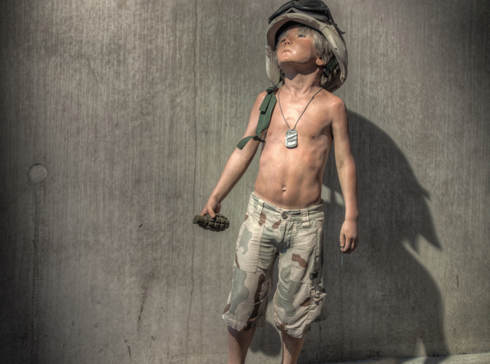 Schoony - Boy Soldier (28mm Tall) 3d printed This Boy Solider has been seen all around the world and now you can get your own.
