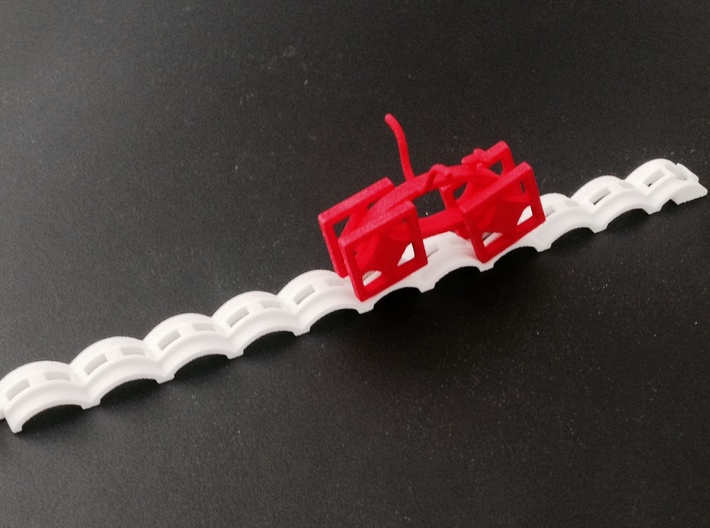 Catenary Track 3d printed A red Retro Bike on a white Catenary Track