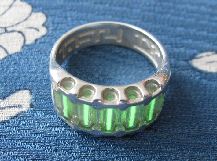 US8 Ring IX: Tritium 3d printed In this picture the phosphorus coating on the tritium vial being energised by UV light.