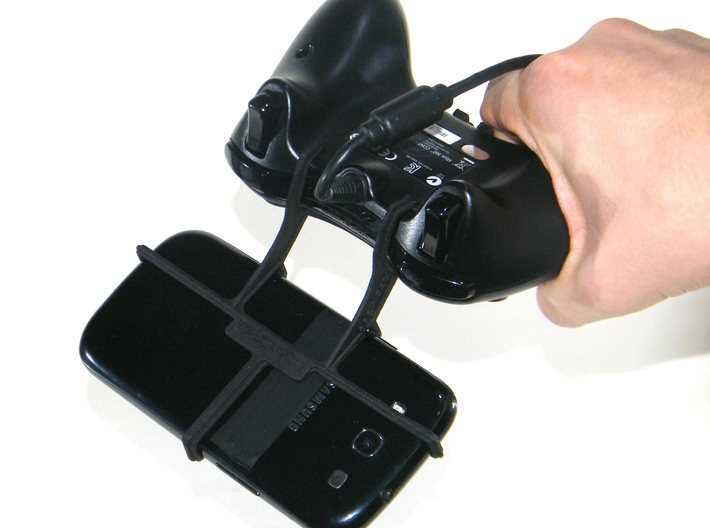Xbox 360 controller & Celkon Q500 Millennium Ultra 3d printed In hand - A Samsung Galaxy S3 and a black Xbox 360 controller