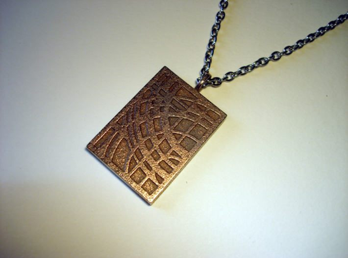 World Pendant 3d printed Stainless Steel - Photo of an actual printed item (chain not included)