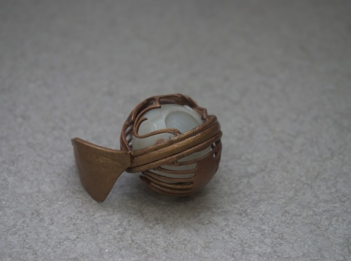 Golden Snitch (bottom) 3d printed used gold paint from a crafts store