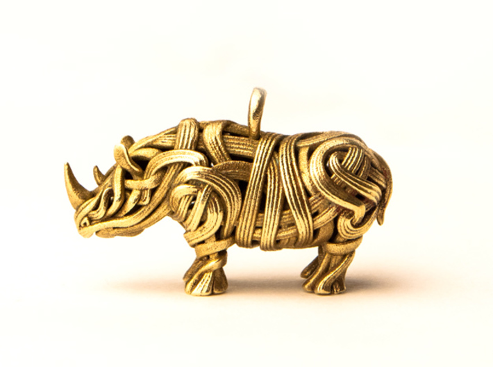 The Rhino Pendant 3d printed Rhino pendant 3D printed in Raw Brass