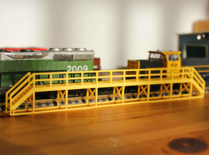 N Scale Train Maintenance Platform SINGLE STAIR LE 3d printed Train maintenance platform with two stairs in Yellow Strong & Flexible Polished, straight of the box. NB: the model in the picture differs from the one on this page.