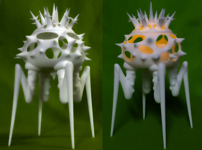 Biomorphic Object #15- Lantern 3d printed The image on the right shows the object with a LED candle inside it.