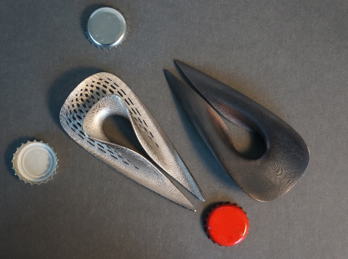 Zisch... Bottle Opener with perforated pattern 3d printed Left: Polished Nickel with Pattern. Right: Polished Grey without Pattern