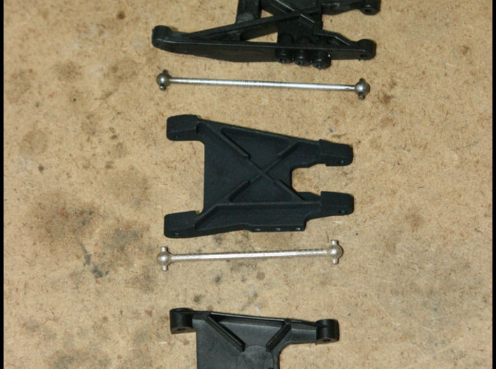 """2.7"""" Dog Bones 3d printed Pictured in the center with my custom 3D printed rear arms.  Compared to stock RC10T stuff on top and stock RC10 buggy stuff on the bottom."""