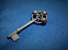 Three skulls key 3d printed Printed in polished Bronze steel, this key has nice weight to it in the hand.