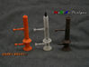 """Goofy Bolt-01-Jan-2016 Cutaway 3d printed Prototypes (Orange Strong & Flexible Polished, Frosted Ultra Detail, Matte Bronze Steel).  A 4mm [5/32""""] rod illustrates how the optional mounting method is used.  Hole Plugs still attached to the prints."""