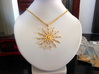 Pendant-Sun 3d printed Photo of the pendand from Polished Gold Steel