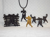 Spike The Zombie Pendant 3d printed Group of Zombie Pendants, unpainted plastic, polished gold steel & matte black steel.