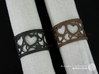 Set of 2 large napkin rings with Hearts 3d printed The photo shows an own print (FDM print) made of brown and black wood incl. decorative lacing.