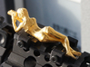 Rail_Figure_Spotter-G_Metal_Body 3d printed PolishedGold Steel, it's an old version.