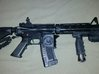Durable M4/AR15 Magwell Grip 3d printed Same Magwell grip with a different emblem