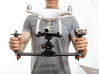 Tripod Mount Adapter for DJI Phantom 4 Drones 3d printed Mounting Plate in use to attach the Phantom 4 to a hand held dual grip stabilizer.