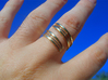 Bars & Wire Ring Size 7½ 3d printed Photo of the ring from the top, printed in polished brass, size 10.