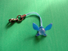 Zelda Navi Fairy Charm 3d printed painted blue and attached to cell phone lanyard