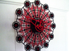 Kaleidoscope Clock - Part B 3d printed The completed Kaleidoscope Clock with Part A in Black Strong & Flexible and Part B in Red Strong & Flexible.This is a two-part clock face kit. This model is Part B. The first part is available at http://www.shapeways.com/model/580491