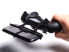 PS4 controller & XOLO Q2500 3d printed In hand - A Samsung Galaxy S3 and a black PS4 controller